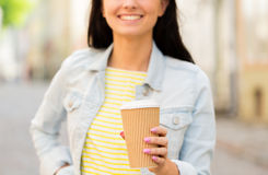 Close up of happy young woman drinking coffee Royalty Free Stock Image