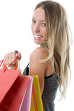 Close-up of happy young woman on a shopping spree. Isolated on white background Royalty Free Stock Photography