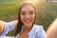 Close up of a happy young woman taking a selfie stock photos