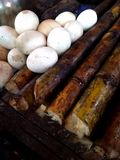 Eggs and sugarcanes. Close-up of hard-boiled eggs and sugarcanes, street food sold to warm the the body up in the mountain where the weather is cold Stock Image