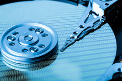 Close up of hard disk with binary language reflection on surface Royalty Free Stock Images