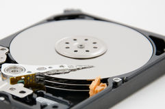 Close up of hard disk plate and reader head Royalty Free Stock Photos