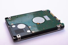 A close-up of a hard drive. The technology of data storage on the computer. Winchester stock images
