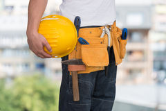 Close-Up Of Hard Hat Holding By Construction Worker Stock Image