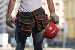 Close-Up Of Hard Hat Holding By Construction Worker Stock Photos