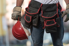 Close-Up Of Hard Hat Holding By Construction Worker Royalty Free Stock Image