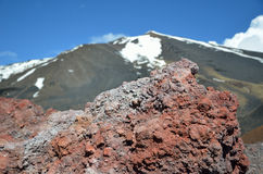 Close-up of hardened lava against the mount Etna Royalty Free Stock Photo