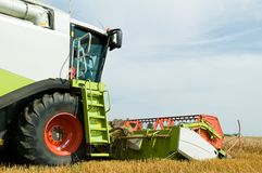 Close-up harvesting combine Stock Image