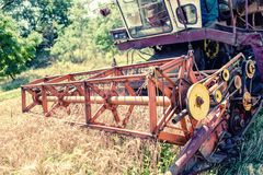 Close-up of harvesting combine in grain and wheat crops Stock Image
