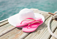 Close up of hat and slippers at seaside Royalty Free Stock Photography
