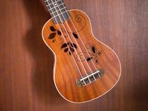 Close up of hawaii ukulele. Flower sound hole Royalty Free Stock Photos
