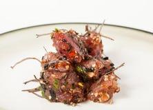 Plate of Hawaiian Poke Raw Fish Prepared with Onions and Seaweed stock photos
