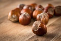 Close up of hazelnuts on a wooden table Royalty Free Stock Image