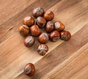 Close up of hazelnuts on a wooden table Stock Photo