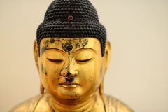 Buddha head. Close-up with the head of a Buddha statue Stock Photo