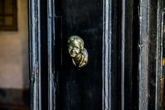 Head knock on a black door royalty free stock image