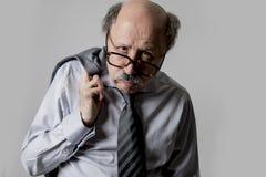 Close up head portrait of bald 60s senior business man sad and d royalty free stock photos