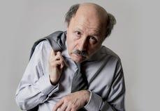 Close up head portrait of bald 60s senior business man sad and d Stock Photo