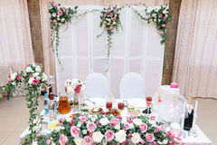 Close up head table for the newlyweds at the wedding hall. Close up head table for the newlyweds at the wedding hall Stock Photography
