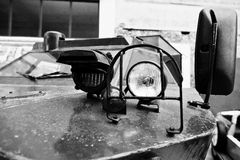 Close up headlight on armored military car. Black and white Royalty Free Stock Photos
