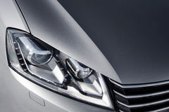 Close up headlight of grey car at daytime Royalty Free Stock Image