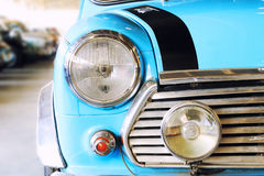 Close Up of Headlight Lamp Blue Vintage Classic Car Stock Image