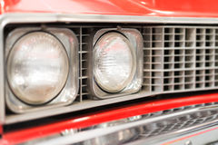 Close Up of Headlight of Red Classic Car Royalty Free Stock Photos
