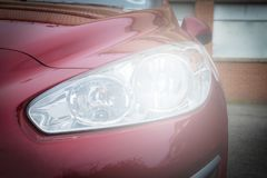 Close-up headlight of red modern car royalty free stock image
