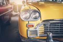 Close up headlight of yellow Retro classic car. Vintage tone Royalty Free Stock Photos