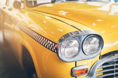 Close up headlight of yellow Retro classic car. Vintage tone Royalty Free Stock Images