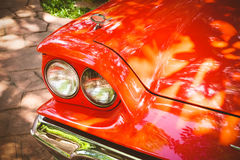 Close-up of headlights of red vintage car. Close-up of headlights of red retro vintage car Royalty Free Stock Photo