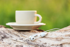 Close up Headphones and Coffee cup on the wood Royalty Free Stock Photography