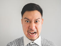 Close up of headshot of angry face man. stock image