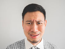 Close up of headshot of crying face man. Close up of straight face of crying Asian man with light beard Stock Image