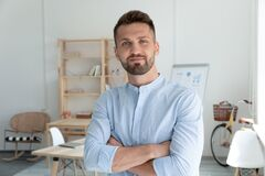 Free Close Up Headshot Portrait Picture Of Smiling Businessman Crossing Hands. Stock Images - 183172014