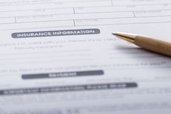 Close-up of Health Insurance Claim Application Form with pen Royalty Free Stock Image