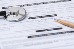 Close-up of Health Insurance Claim Application Form with pen and Stock Photo