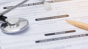 Close-up of health insurance form,Stethoscope and pen on a healt Royalty Free Stock Images