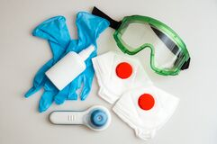Health Protection Kit for the Coronavirus Pandemic COVID-19. Respirators, protective glasses, thermometer, medical masks, rubber