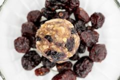 Close up healthy energy ball among dried berries in glass bowl i. Solated on white background royalty free stock photography