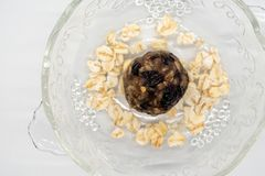 Close up healthy energy ball among rolled oat flake in glass bow. L on white background royalty free stock photo