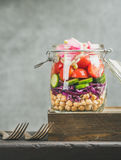 Close-up of Healthy layered take-away salad with vegetables, chickpea sprouts Stock Image