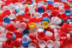 Colorful plastic bottle caps ready for recycling. Close up of heap of colorful plastic bottle caps ready for recycling Royalty Free Stock Images