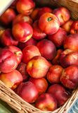 Close up of heap of nectarine. In the braided basket stock photo
