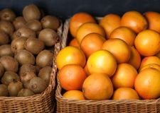Close up of heap of oranges and kiwis. Concept of healthy food royalty free stock photo