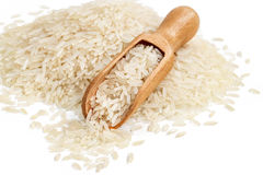 Close up of heap parboiled rice and wooden scoop isolated on white background. stock photography