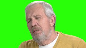 Close up heart attack, green screen. Unhealthy senior man suffering from pain in chest, chroma key background stock video