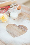 Close up of heart of flour on wooden table at home Royalty Free Stock Images