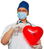 Close-up heart in the hands of a doctor. Close-up heart in hand, doctors isolated on white Royalty Free Stock Photography