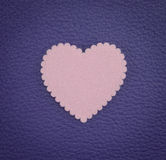 Close up heart pink on leather purple vintage background Royalty Free Stock Photography